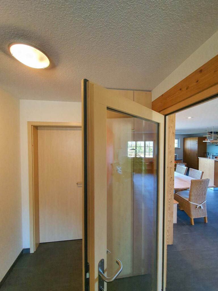 Wooddesign_Raumtrenner_Türen_Schiebetüren_Akustikverkleidungen_Altholz_Wandverkleidung_Glasfüllung_LED Beleuchtung (10)