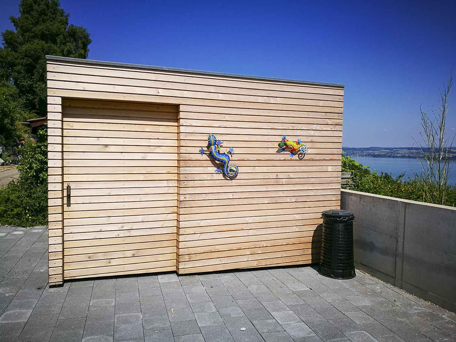 Wooddesign_Terrassengestaltung_Veounterstand_Carport_Lärchenholz vergraut_Holzverschalung_Schiebetüre-Flachdach (1)