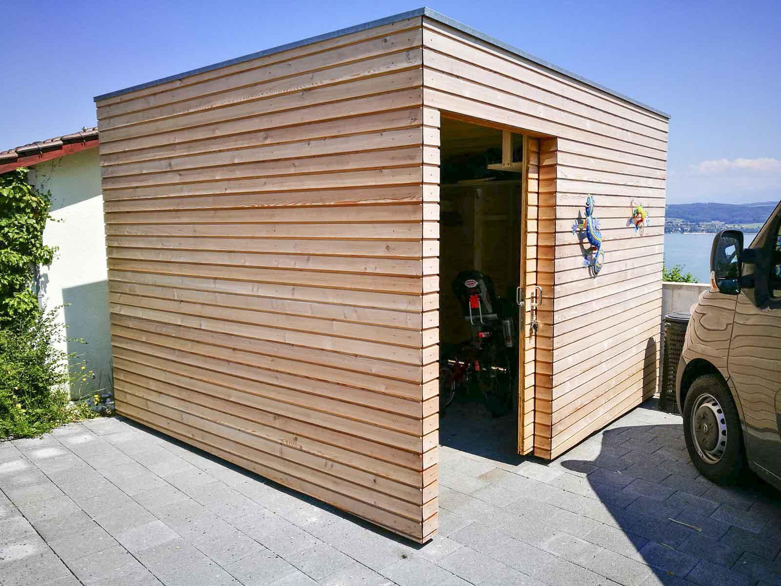 Wooddesign_Terrassengestaltung_Veounterstand_Carport_Lärchenholz vergraut_Holzverschalung_Schiebetüre-Flachdach (4)